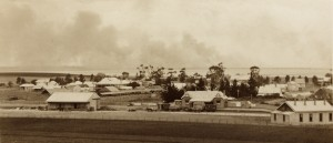 Sorell township c1920 - looking south over sale yards and train station in centre, bushfire smoke from in the distance